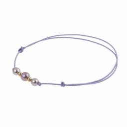Bracelet en or jaune sur cordon polyester mauve et perles de culture