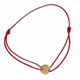 Bracelet en or jaune sur cordon de coton fuschia