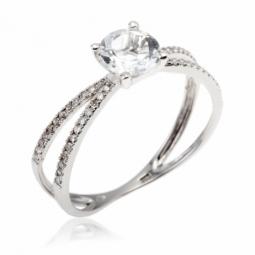 Bague en or gris, topaze blanche et diamants