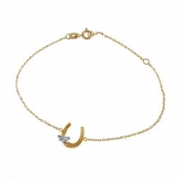 Bracelet en 2 ors et oxyde de zirconium, motif fer à cheval et libellule