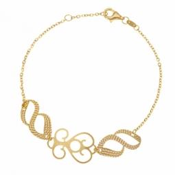 Bracelet en or jaune, motifs ajourés mats et diamantés