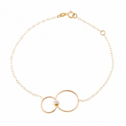 Bracelet en or jaune, motif cercles et boule facetée en or rhodié
